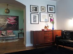 KEOGH HABERMANN | DREAMY LIVING ROOM REVEAL: gallery wall over mid century modern credenza and mural over a Roseate Spoonbill from @surfaceview