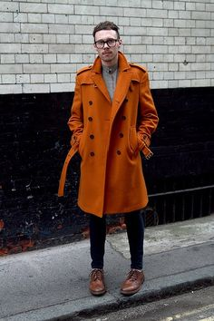 Reach for an orange overcoat and navy skinny jeans to create a smart casual look. A pair of brown leather brogues will seamlessly integrate within a variety of outfits. Shop this look for $1,484: http://lookastic.com/men/looks/grey-longsleeve-shirt-brown-brogues-navy-skinny-jeans-orange-overcoat/4697 — Grey Longsleeve Shirt — Brown Leather Brogues — Navy Skinny Jeans — Orange Overcoat