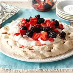 Two-Berry Pavlova Recipe -Here's a light and airy dessert that I first tried in Ireland. When I got home, I made it for my kids, who loved to build their own with their favorite fruits. The whipped cream makes for icing on the cake! —Norma Stevenson, Eagan, Minnesota