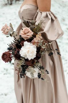 Cappuccino Roses, Peonies and Chrysanthemums are gathered to create a Winter Wedding Bouquet of dark and moody colours. Blush wedding dress with billowing silky sleeves. Shot in Calgary Alberta, for Canadian Brides wanting a winter wedding. Diy Wedding Bouquet, Rose Wedding, Floral Wedding, Bridal Bouquets, Chic Wedding, Blush Winter Wedding, Winter Wedding Flowers, Chrysanthemum Bouquet, Chrysanthemums