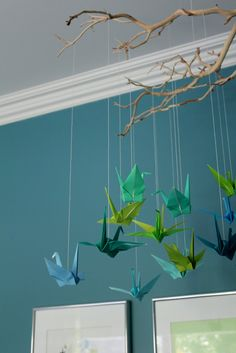 teal wall colour for nursery with white ceiling. LOVE the mobile!