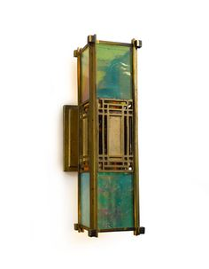 Frank Lloyd Wright WALL SCONCE designed for the Francis W. Little House, Peoria, Illinois, brass-plated bronze and iridized opalescent glass, circa 1903 Franck Loyd Wright, Lloyd Wright, Frank Loyd Wright Houses, Wall Sconce Lighting, Cool Lighting, Wall Sconces, Craftsman Style, Craftsman Homes, American Craftsman