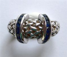 John Atencio Ring - Designed and signed by John Atencio. Made with sapphires and 18kt white and yellow gold. A250-113. (subject to prior sale) -- Lilliane's Jewelry -- 4101 W. 83rd St. Prairie Village, KS 66208 -- 913-383-3376 –