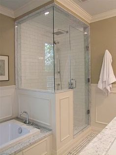 simple color scheme, subway tiles in the shower and white trim throughout.