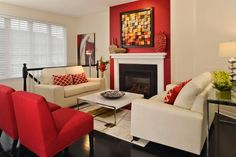 Neutral walls and furniture help to expand this small living space visually, while punches of bold red add color and life to the room. To make the fireplace the focal point of the room, the area around it is painted red.