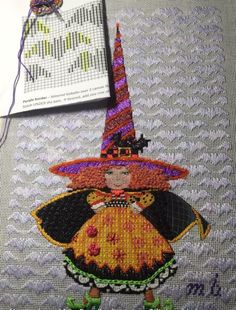 needlepoint witch (designer unknown) with bat pattern darning background