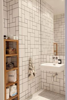 Gorgeous herringbone bathroom tiling via Cush and Nooks