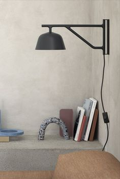 The wall version of Muuto's Ambit rotates up to 120 degrees and the metal shade can be turned to each side for either direct or indirect light. #AplusR #moderndesign #interiordesign #modernlighting #livingroomlighting #walllamp #wallsconce #muuto #TAFarchitects