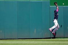 Out of reach - Center fielder Cameron Maybin of the Atlanta Braves cannot make a catch on a hit by Bryce Harper of the Washington Nationals in the first inning at Nationals Park on May 10 in Washington, DC. - © Patrick Smith/Getty Images