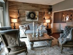 Deconstructed reupholstered sofa Deconstructed wingback chairs Grey and burlap Reclaimed wood wall Rustic Rebel Interiors