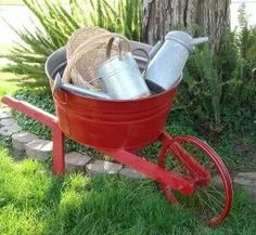 home-made wheelbarrow made from antique bike wheel and galvanized tub