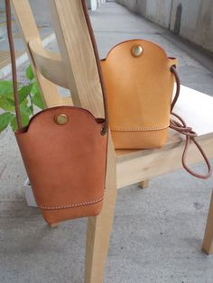 Hand Stitched Light Brown Leather phone Case/ Small Pouch. $75.00, via Etsy.