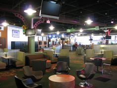 This lounge was part of a project completed at Christ Community Church St. Charles, Illinois. This industrial themed project consisted of adding in a youth worship area with a lounge, technology and gaming area, and a cafe to encourage youth fellowship. Interior design by PWA. #church