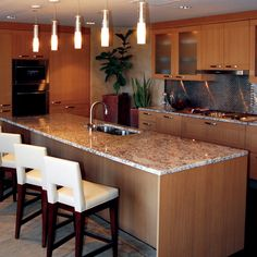 Granite Slabs are cut from quarried granite blocks. A key use of granite slabs is in the production of kitchen counter tops where their durability and beauty make them ideal. Granite Slab, Kitchen Countertops, Marble, Home Decor, Kitchen, Decoration Home, Room Decor, Granite, Marbles