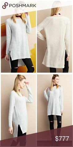"Arrives next week! Like to be notified! Cozy up to this knit hi low sweater featuring long sleeve and round neck. Color: heather grey. Front length: 21"", back length: 31"". 100% acrylic. Price: $50. Like to be notified when in! Unity Blend Tops Tunics"
