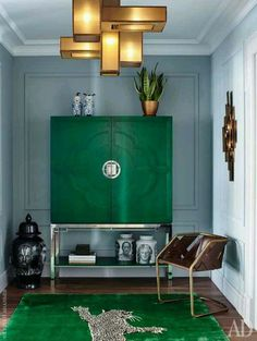 Stunning room. Love jewel green cabinet and gold fixture.