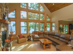 Grand living room windows overlooking Gull Lake in Lake Shore, MN