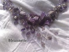 Completely unique to you,as they are one of a kind no two pieces will ever be the same.  This great necklace is made with ametist stone , freshwater pearls, purple cats eye beads, crystal beads and use crochet technique with stainless steel wire,finished with silver plated clasp lock handmade.  SIZE : 52-55 cm