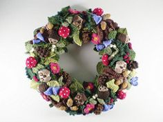 This is the first in a series of twelve linked patterns for a knitted wreath, to be published daily in December 2013.