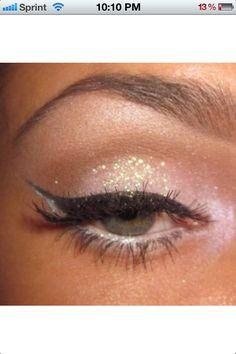 Glitter eyeshadow with cateyeliner. Pretty.