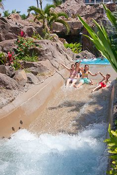 www.enchantedhoneymoons.com  (402.390.9291)  Kids on the slide at Grand Wailea Resort & Spa in Maui, Hawaii.  This was voted one of the top 12 pools in the world.