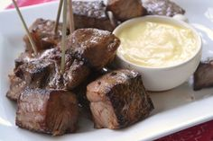 Steak Bites with Garlic Aïoli Recipe Main Dishes with steak, dark soy sauce, garlic cloves, fresh ginger, lemon juice, sesame oil, freshly ground black pepper, large egg yolks, lemon juice, dijon mustard, olive oil, garlic cloves, salt, freshly ground black pepper