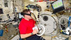 Astronauts pilot a jetpack in virtual reality.