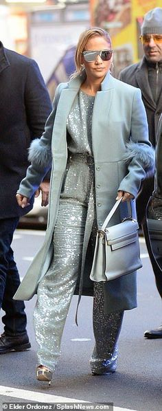 3d2bf82cee64 Jennifer Lopez dazzles in glittering ice blue jumpsuit as