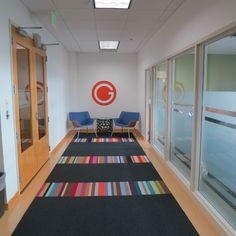 FLOR / Parallel Reality - Multiple Colors, Made You Look - Flint / GLOTO / Fulton, MD / The bright white walls, minimalist style and FLOR area rug with pops of color all work together to bring this small office space to life.