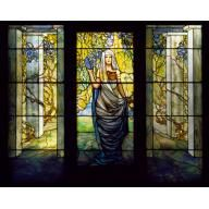 stain glass: portrait of a woman in a pergola with wisteria. tiffany studios