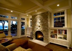 Hearth Room with stone fireplace, beamed ceilings and hidden TV on automatic lift.