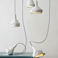 http://remodelista.com/posts/modern-alchemy-concrete-lamps-made-to-look-like-paper#