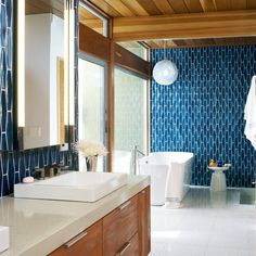 Check out the high-meets-low revamp in this Las Vegas bathroom renovation––plus easy tricks to transform your own space.