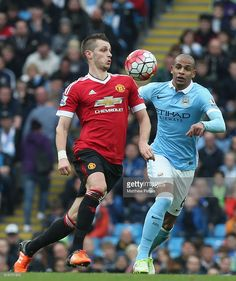 Morgan Schneiderlin of Manchester United in action with Fernando of Manchester City during the Barclays Premier League match between Manchester City and Manchester United at Etihad Stadium on March 20, 2016 in Manchester, United Kingdom.