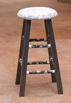 Give a plain wood stool a makeover with metal accents, fabric, and paint.