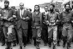 Ernesto y Fidel en una marcha