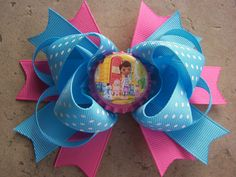 Doc McStuffins Inspired Hair Bow featuring Doc, Chilly, Lambie, and Hallie. $5.99, via Etsy.