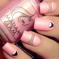 Minimum details are sometimes the best. Check out this baby pink nail art design rocking silver metallic polish and beads.