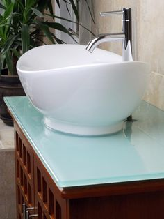 No matter the style, a vessel sink will add a touch of elegance. Vessel sinks — in stone, glass and metal — have come down in price since they first became popular. Smaller bowls are perfect for half bathrooms and powder rooms. Powder Room Decor, Diy Bathroom, Diy Bathroom Vanity, Vessel Sink Bathroom, Master Bathroom Renovation, Sink Faucets, Bathroom Sink, Bathroom Sink Bowls, Sink