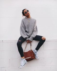 Sweater, jeans, chucks.