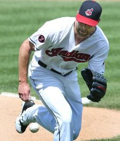 Corey Kluber grabs the ground ball hit by the Kansas City Royals Alcides Escobar fist inning, on July 29, 2015 at Progressive Field.  Indians won 12-0.  (Chuck Crow/The Plain Dealer)