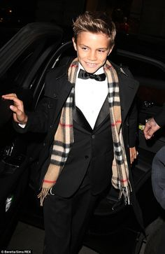 Already a star: Romeo made an entrance worthy of an experienced model as he arrived with his parents