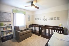 Drew and Jake's Warm Neutral Nursery. Love the baby names on the wall like this for twins above the cribs