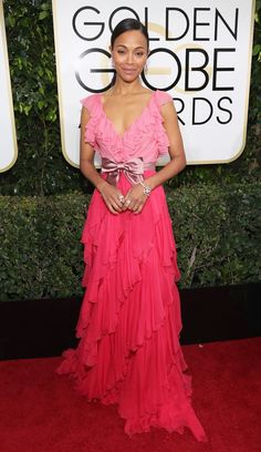 2017 Golden Globes: Zoe Saldana is wearing a pink ombre Gucci gown with ruffles and a bow belt. My favorite shades of pink in a dress! The dress is feminine with the ruffles.