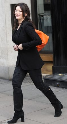 Then add a dash of orange! A shrinking Nigella Lawson spices up her 'dull black uniform' with a bright bag 5 oct 2012 Love Fashion, Womens Fashion, Orange Bag, Bellisima, Her Style, Women Wear, Sexy, Bago, Celebs