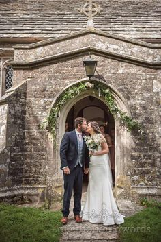 Newlyweds kiss outside church in Dorset #newlyweds #kissing #dorsetwedding