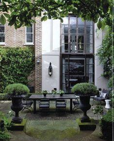 Pair of black garden urns with boxwood buxus formal garden Townhouse Garden, Garden Urns, Fence Garden, Black Garden, Garden Landscape Design, Outdoor Living, Outdoor Decor, Dream Home Design, Atrium
