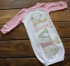 This listing is for a super soft baseball raglan style baby gown with light pink sleeves and personalized with a name in shades of mint, light pink