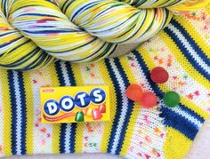 """This is part of my brand new Candy Jar collection! This is for a single  hank of """"Dots"""" self striping sock yarn. This yarn is also available as a  bundle that includes the other candy yarns and a drawstring bag.  460 yards/100gram hank  75% superwash wool, 25% nylon  Gauge: 7-8 stitches/inch on #1-3 needles  machine wash cold, tumble dry low"""