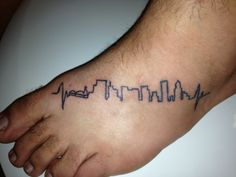 """My """"home is where the heart is..."""" Tattoo. I am from Portland, Oregon so I got the skyline of Portland, but to make it more flush I added a simple heartbeat on each side of the city. I love this tattoo. Got it on May 23, 2012 in Clearwater, FL at Rocco's Tattoo shop by the artist who goes by the name of Sarah."""